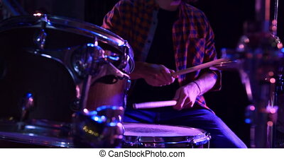 Musician performing during a concert - Front view close up ...