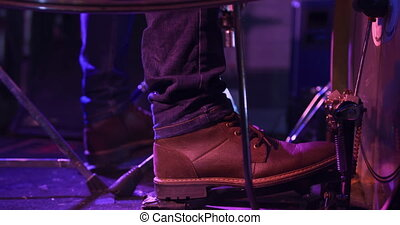 Musician performing during a concert - Side view low section...