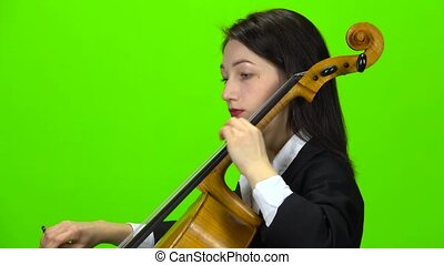 Musician play cello. Green screen. Side view. Close up -...