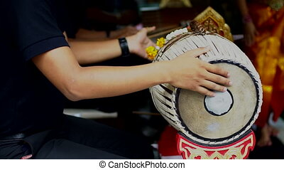 Musician playing 2 faces drum