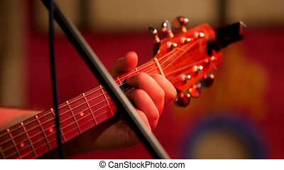 Musician playing acoustic guitar - guitar soundboard, close...