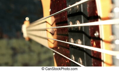 Musician playing bass guitar, closeup shot of string...