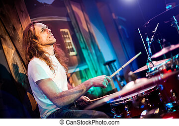 playing drums - musician playing drums on a red background
