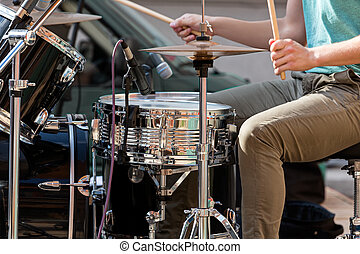 Musician playing drums on stage - Street performing drummer...