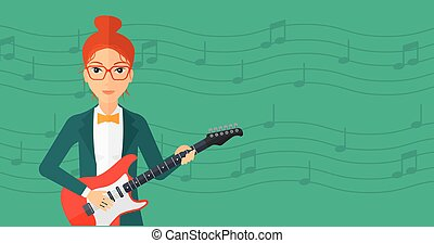 Musician playing electric guitar. - A smiling woman playing...