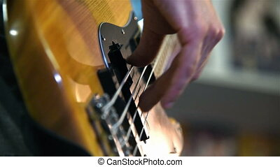 Musician Playing On A Bass Guitar. Slow Motion Effect