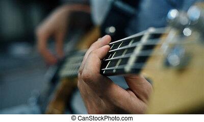 Musician Playing On A Bass Guitar