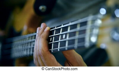 Musician Playing On Bass Guitar. Close Up. Slow Motion...