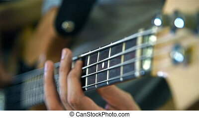 Musician Playing On Bass Guitars. Close Up