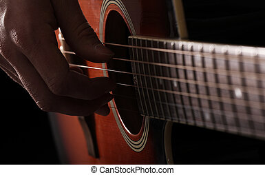 Musician playing on guitar - Musician playing on acoustic ...