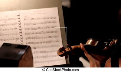 musician playing on violin