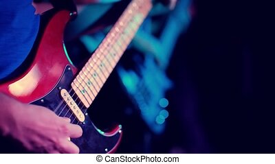 Musician playing some chords on electric guitar