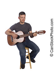 Musician playing - Guitarist playing isolated on a white...