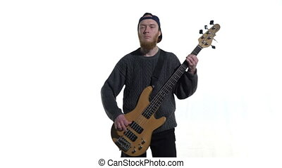 Musician playing the bass guitar - Musician playing bass...