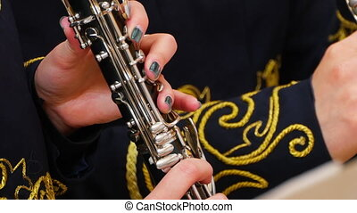 Musician playing the clarinet, closeup - Hands close-up...