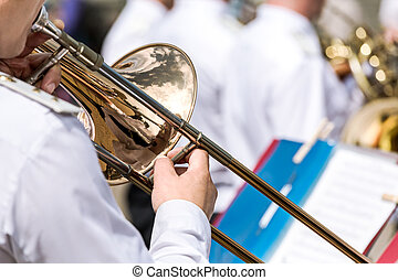 musician playing the trombone in the military orchestra