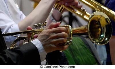Musician playing the trumpet, closeup - Hands close-up...