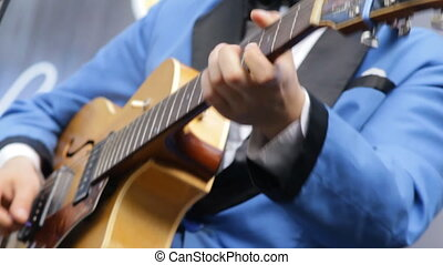 Musician playing vintage the guitar close-up.