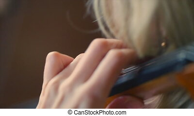 Musician Playing Violin - Close-up of musician playing...