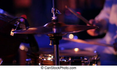 musician plays drums