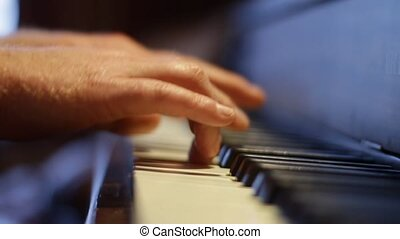 Musician Plays Piano - male hands playing upright piano