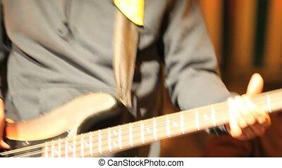 musician plays the bass guitar