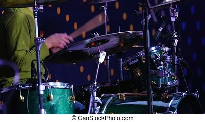 Musician plays the drum set at the concert