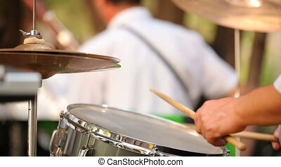 Musician plays the drums