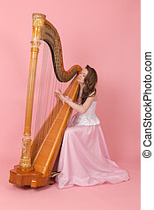 musician plays the harp