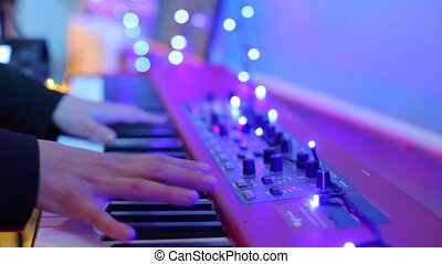 musician plays the keys at a concert