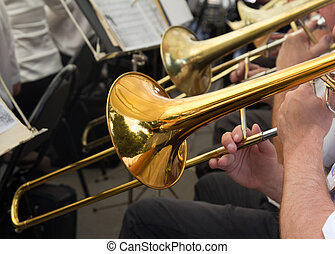 musician plays the trumpet in the orchestra