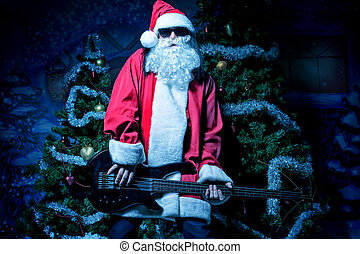 musician - Portrait of a singing Santa Claus with electric...
