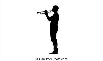 Musician professional playing on trumpet in slow motion. Black silhouette