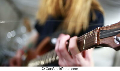 Musician rehearsing on a electric guitar