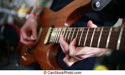 Musician rehearsing on a electric guitar. rock band