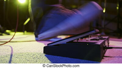 Musician using a pedal point in a music studio - Low angle ...