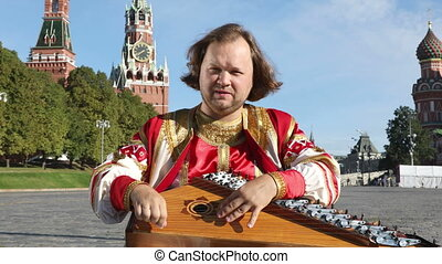 Musician with music instrument gusli, Russia - The musician...