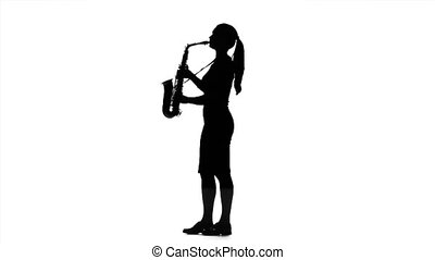 Musician woman playing on saxophone in slow motion. Black silhouette