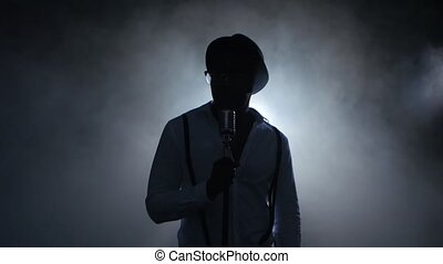 Musician young african american in the smoke and white light...