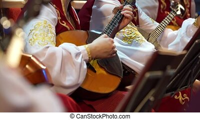Musician's arm tuning musical instruments - Close up shot of...