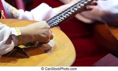 Musician's arm tuning musical instruments