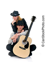 Musicians, couple - Handsome young male and female musicians...