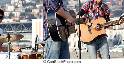 Musicians in concert, Two guitar player