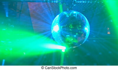 Laser show, with dancers on stage and many people dance in...
