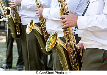 musicians playing the saxophones in military orchestra