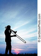 Musicist at sunset - illustration of a musicist at sunset