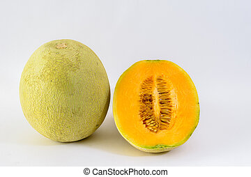 Musk melon with sliced portion on white background