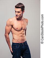 muskulös, junger mann, weg schauen