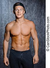 muskulös, mann, in, kappe, mit, a, textilfreie , oberkörper