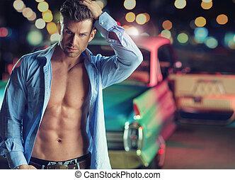 muskulös, ung man, med, den, retro, bil